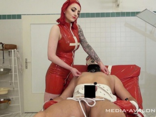 Bizarre doctor Miss Decadoria prepares her patient for 	stimulation current session