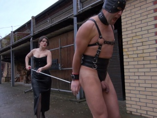 mistress tortures slave outdoor