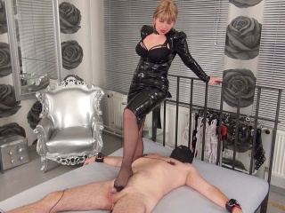 Mistress wears black nylons and teases the slaves cock with her foot