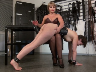 Mistress is spanking a slavegirl
